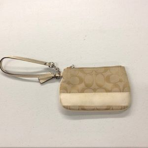 This is a Coach Coin Purse